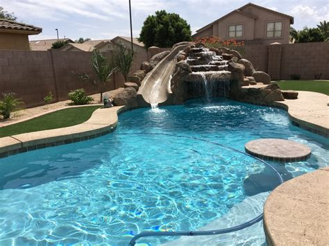free form and style free style swimming pools construction grotto slide desert soul landesign pools landscape