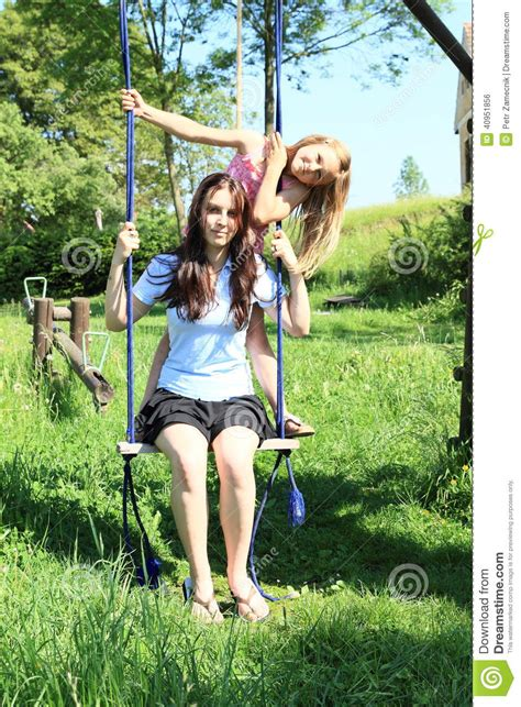 girls on swings girls swinging on swing stock photo image 40951856