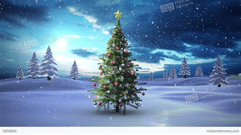 christmas tree with snow falling on it christmas decore