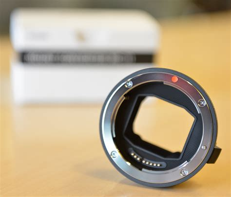 the new sigma 50 100mm f 1 8 dc hsm lens and mc 11