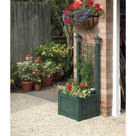 planters with trellis trellis planter with solar lanterns verdigris garden