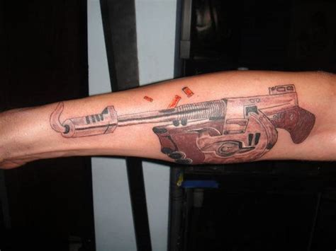 big gun tattoo design on sleeve busbones