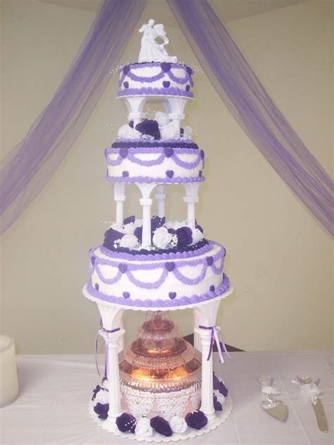 purple hearts swags wedding cake w this was a 3 tier on columns wedding cake i
