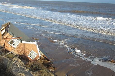 houses falling off cliffs storm wreaks havoc across the uk in pictures