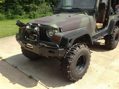 4 door jeep wrangler jacked up jacked up 1997 camo jeep 5 speed low 10 000