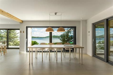 modern lake cottage  nordic inspired design  saint