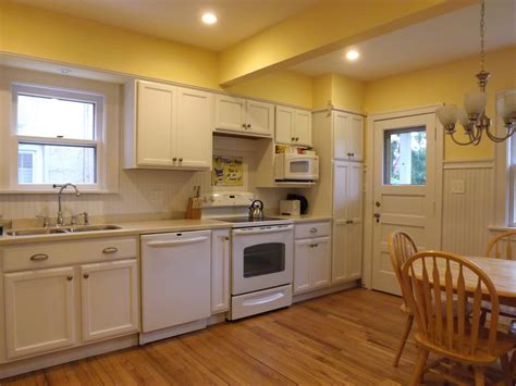 yellow kitchen with white cabinets white kitchen white beadboard back splash kraftmaid