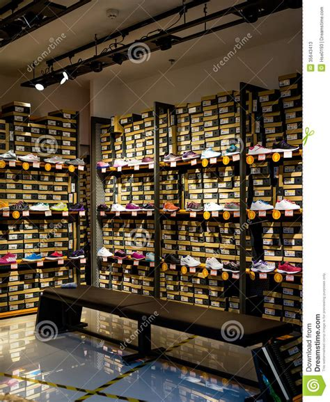 sporting shoe stores sports shoes on shelves for sale editorial stock photo