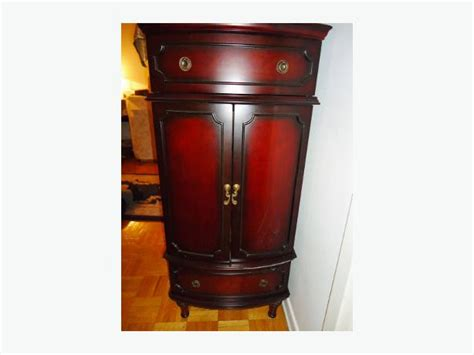 Bombay Jewelry Armoire by Bombay Company Cherry Mahogany Jewellery Armoire Sold