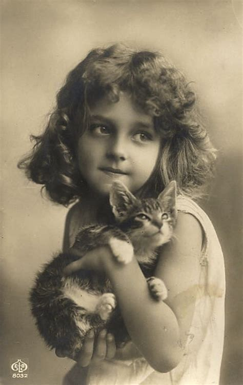 vintage everyday vintage photographs of girls with their cats