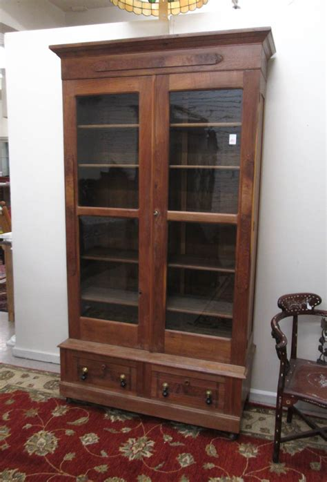 walnut cabinet bookcase on base america