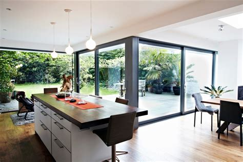 designing a house extension house with floor to ceiling glass and beautiful nature views
