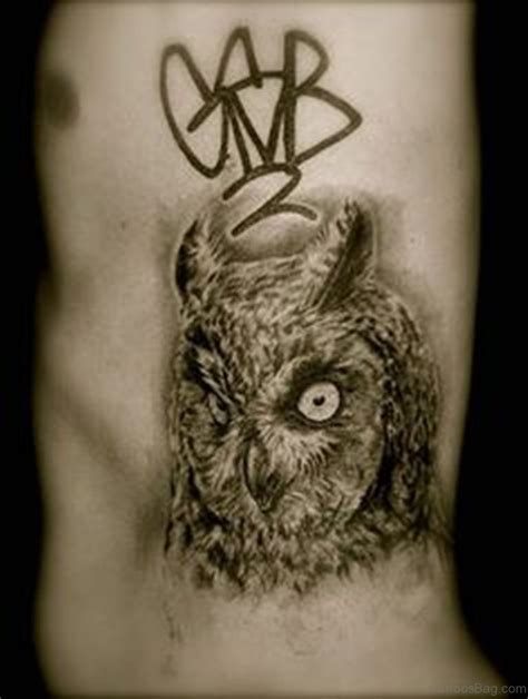 owl face tattoo 47 mind blowing owl tattoos on rib