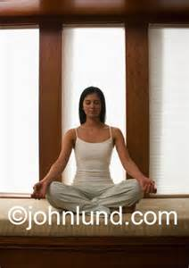 Lotus Position In Bed Beautiful Ethnic Meditating In The Lotus Postion At Home