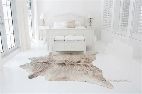 cowhide rug bedroom light brindle cowhide rug contemporary bedroom other by jersey road