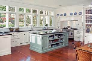 Hamptons style kitchen featuring duck egg blue island image source