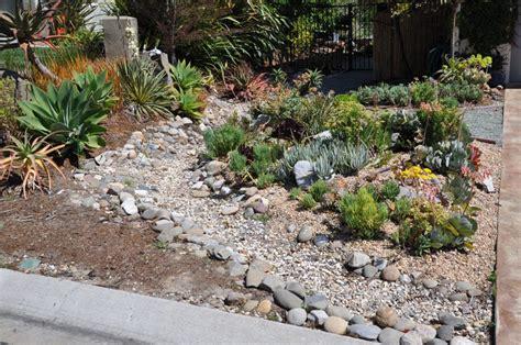 Succulent Garden And Dry Creek Bed Landscaping Between Rock Creek Garden