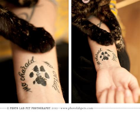 tattoo printer ink black ink memorial wrist tattoo of dog paw print with