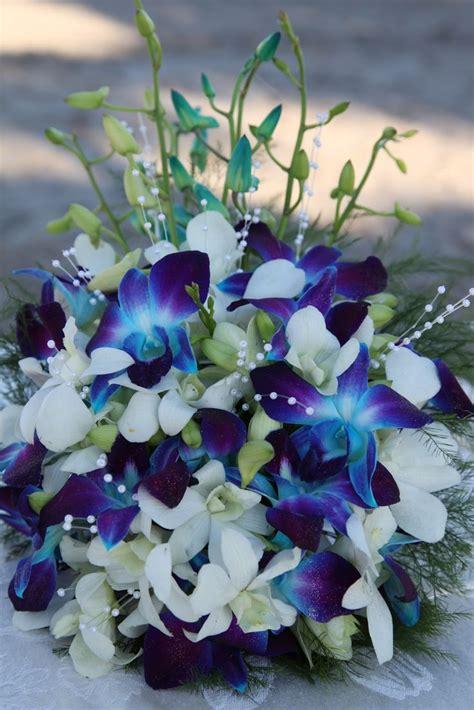 royal blue dark orchid arrangement real wedding gabriel