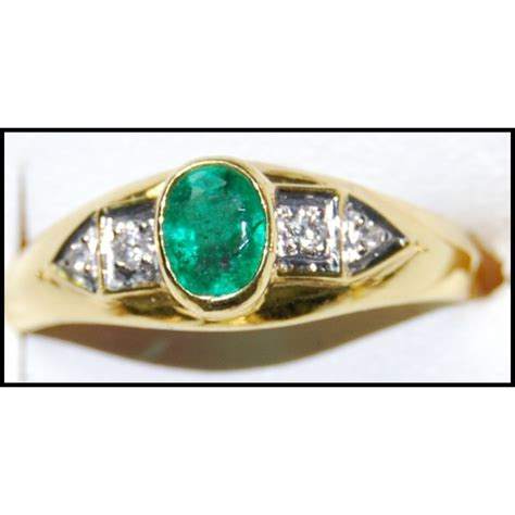 genuine emerald 18k yellow gold solitaire ring