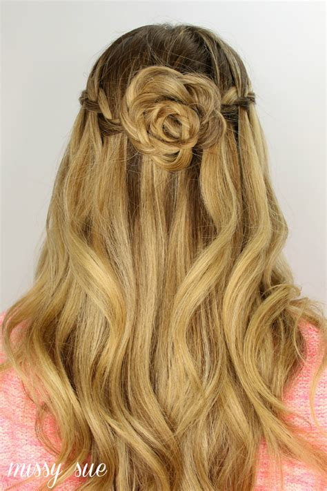 flower girl hairstyles half up half down waterfall braid and flower bun