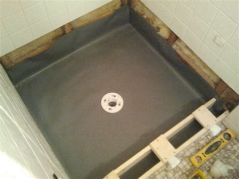 Shower floor repair pan liner curb and finish coat tile contractor creative tile works