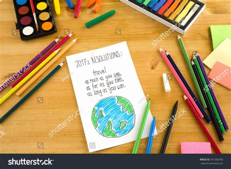Handmade Graphic Design - new years resolutions on wooden background stock photo