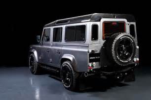 land rover defender gets out by truck