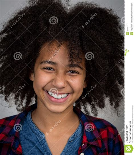 mixed nationality teen short hairstyles mixed race girl with afro hair style laughing stock photo