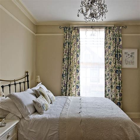 neutral bedroom curtains neutral country bedroom with blue floral curtains