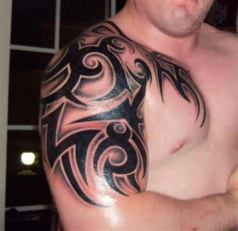 half chest tribal tattoo awesome tribal on shoulder and half sleeve