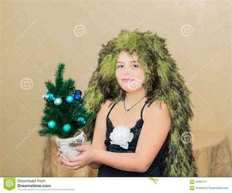 christmas tree girls hair do smiled beautiful with unique hair cut holding small decorated miniature
