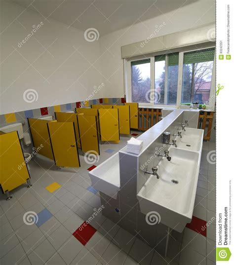 nursery toilet layout inside a bathroom of a nursery school with small toilets