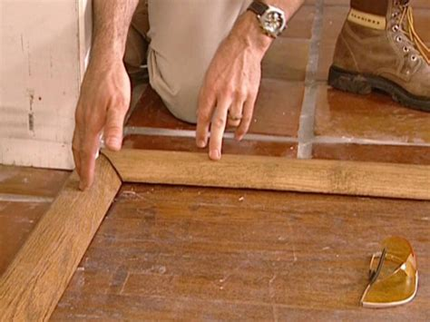 Installing Hardwood Floors Next To Existing Hardwood How To Install A Tile Floor Transition How Tos Diy