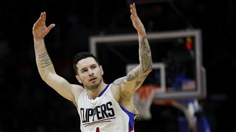 jj redick tattoos j j redick raises his while giving clippers foes the