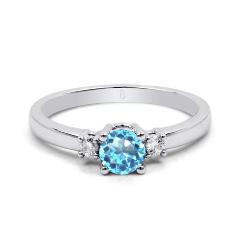 A595 Blue Topaz 6 9 Ct 18ct white gold blue topaz 3 engagement