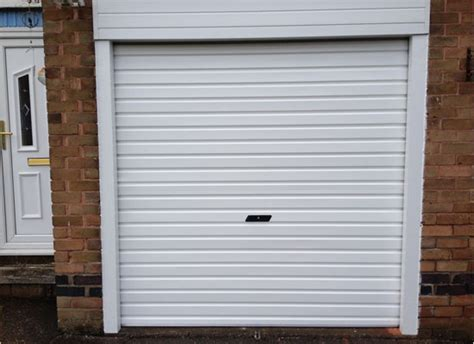 white garage doors white roller garage door fitted protec garage doors ltd
