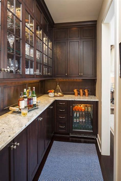 granite countertops with brown cabinets brown pantry cabinets with crema persa granite countertops