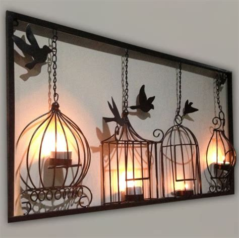 wrought iron wall decor with candles the reflection of