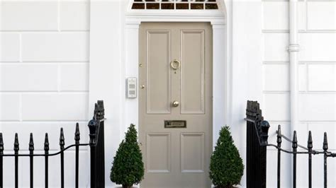 painting your front door in a classic neutral colour smartens up the exterior of your house