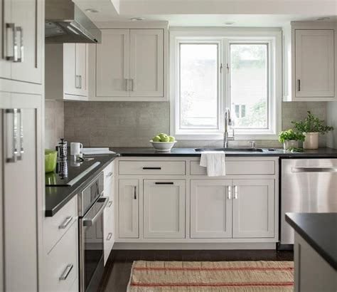 Grey Kitchen Cabinets With Black Countertops by Chic Kitchen Features Light Gray Cabinets Paired
