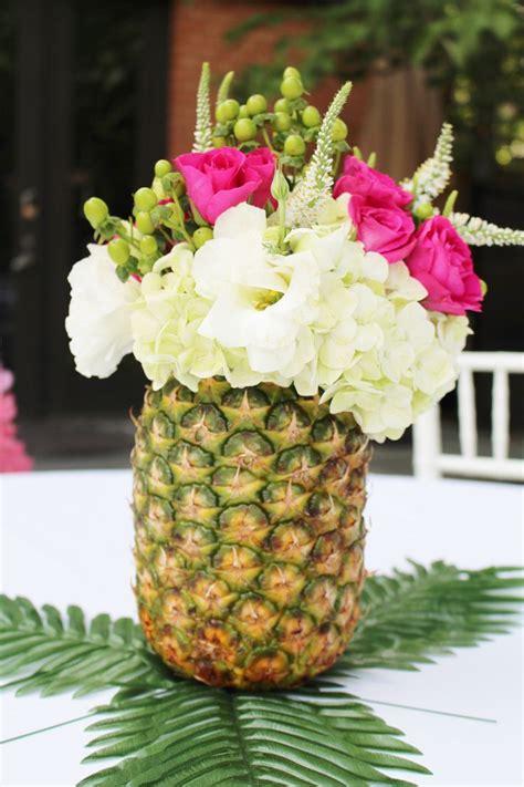 pineapple flower arrangements hawaiian party ideas luau