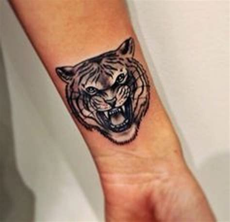 16 pretty tiger wrist tattoos