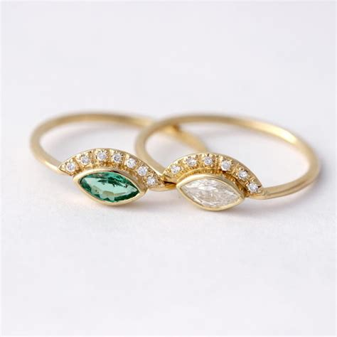 marquise emerald engagement ring with pave diamonds in 18k