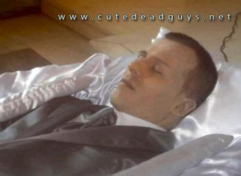 dead man in recliner at funeral home handsome caucasian on his funeral men on their caskets