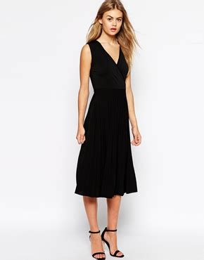 Midi Dress Vb 3 beckham wears plunging black dress to join