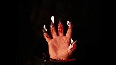 creepy candle hand  bleeds  reveals  skeletal