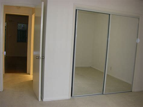 replacing mirrored closet doors sliding mirror closet door repair closet sliding doors