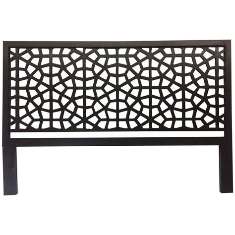 black lacquer headboard black lacquer wood headboard with geometric latticing at