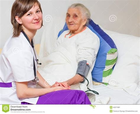 caregiving an lying in bed stock